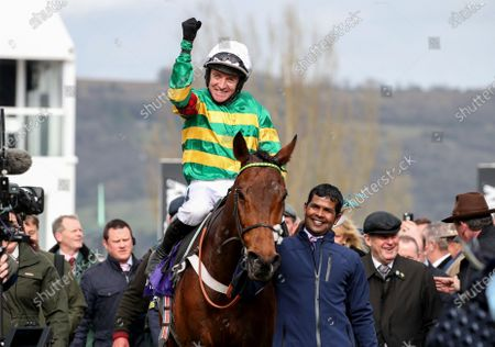 RSA Insurance Novices' Chase. Barry Geraghty celebrates winning onboard Champ with owner JP McManus