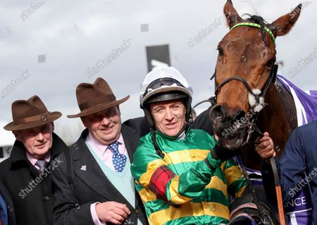 RSA Insurance Novices' Chase. Jockey Barry Geraghty and trainer Nicky Henderson celebrate winning with Champ