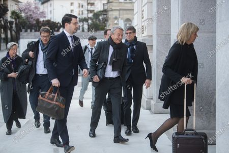Stock Image of Wolfgang Niersbach (C), former president of the German Football Association (DFB), and his team of lawyers arrive at the Federal Criminal Court in Bellinzona, Switzerland, 11 March 2020. Three former German football officials and ex-FIFA Secretary-General will go on trial over suspicions that Germany bought votes to obtain the 2006 World Cup.