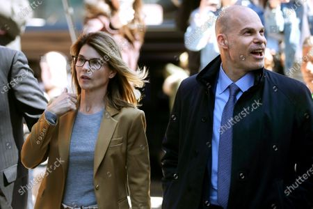 Lori Loughlin, left, arrives at federal court in Boston with her attorney Sean Berkowitz to face charges in a nationwide college admissions bribery scandal. Berkowitz, a former federal prosecutor, has a reputation for being fearless, yet cool-headed and a master at navigating complex cases
