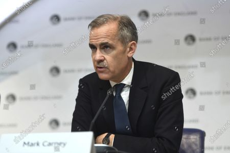 Governor of the Bank of England, Mark Carney, speaks during a news conference at the Bank Of England, in London, . The Bank of England has cut its key interest rate by half a percentage point to 0.25%, as an emergency measure in response to the outbreak of the COVID-19 virus