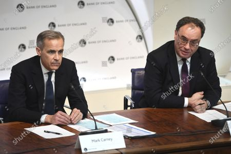 Stock Image of Governor of the Bank of England, Mark Carney, left and Andrew Bailey, governor-designate of the Bank of England take part in a news conference at the Bank Of England, in London, . The Bank of England has cut its key interest rate by half a percentage point to 0.25%, as an emergency measure in response to the outbreak of the COVID-19 virus