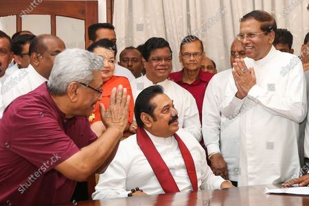 Sri Lanka's President Gotabaya Rajapaksa (L) greets former President Maithripala Sirisena (R) watched by Prime Minister Mahinda Rajapaksa (C) at the party head office in Colombo, Sri Lanka, 11 March 2020. The Sri Lankan President dissolved parliament on 02 March 2020, six months before the end of its term.