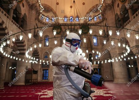 A member of Istanbul's Municipality disinfects the Kilic Ali Pasa Mosque to prevent the spread of the novel coronavirus, in Istanbul, Turkey, 11 March 2020. Turkish Health Minister Fahrettin Koca has announced the first coronavirus COVID-19 case in Turkey.