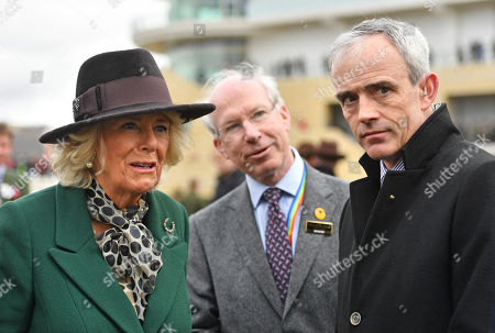 Camilla Duchess of Cornwall with Ruby Walsh (right) as she attends Ladies Day at the Cheltenham Festival