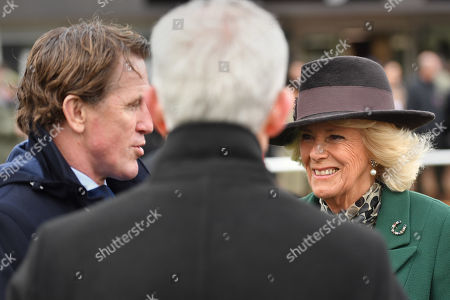 Camilla Duchess of Cornwall with Tony McCoy (left) as she attends Ladies Day at the Cheltenham Festival