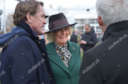 Tony McCoy (left) with Camilla Duchess of Cornwall as she attends Ladies Day at the Cheltenham Festival at Cheltenham Racecourse