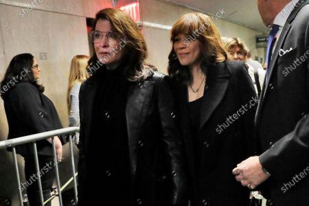 Annabella Sciorra, left, and Rosie Perez, leave court after the sentencing of Harvey Weinstein, in New York