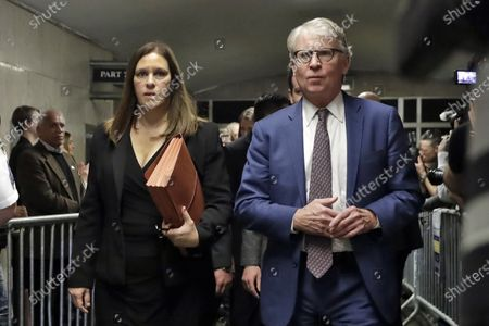 Manhattan District Attorney Cyrus Vance Jr., and Assistant District Attorney Joan Illuzzi, leave court in New York, after Harvey Weinstein was sentenced to 23 years in prison for sexually assault
