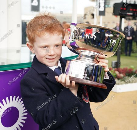 Cheltenham Racecourse Festival Day 2 The RSA Insurance Novices' Steeple Chase. Tony McCoy's son Archie with the RSA Trophy after Champ, the horse named after Tony McCoy and ridden by Barry Geraghty, had won.
