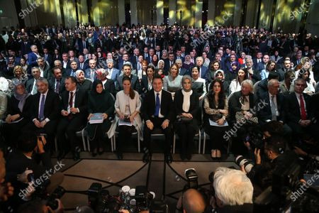 Ali Babacan (C), former Turkish Minister and ally of Turkish President Recep Tayyip Erdogan, and his wife Ulku Zeynep (C-R) pose for media during a ceremony of launching his new party in Ankara, Turkey, 11 March 2020. Babacan unveiled his new Democracy and Progress Party (DEVA) on 11 March 2020 after he resigned from Turkey's ruling party Justice and Development Party (AK Party) last year.