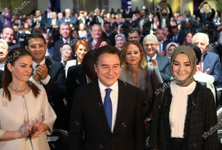 Stock Photo of Ali Babacan (C), former Turkish Minister and ally of Turkish President Recep Tayyip Erdogan, and his wife Ulku Zeynep (R) greet supporters during a ceremony of launching his new party in Ankara, Turkey, 11 March 2020. Babacan unveiled his new Democracy and Progress Party (DEVA) on 11 March 2020 after he resigned from Turkey's ruling party Justice and Development Party (AK Party) last year.