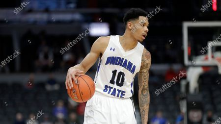 Stock Picture of Indiana State's Christian Williams dribbles during the first half of an NCAA college basketball game against Missouri State in the quarterfinal round of the Missouri Valley Conference men's tournament, in St. Louis