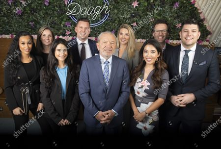 Stock Picture of Lord Alan Sugar with eight of the Apprentice tv show winners, they are, from left - Sian Gabbidon (2018), Mark Wright (2015), Sarah Lynn (2017), Carina Lapore (2019), Susie Ma (2011 - 3rd) Ricky Martin (2012), Leah Totten (2013) and Tom Pellerau (2011) at Dough Bakehouse, Herne Hill
