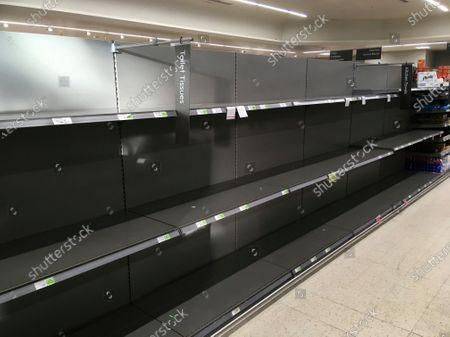 Shelves stand empty in the aisle for toilet rolls, after panic buying as result of the coronavirus, in a branch of the Waitrose supermarket in Surbiton, south west London, . A British government minister Nadine Dorries, who is a junior Heath minster has tested positive for the coronavirus and is self isolating. For most people, the new coronavirus causes only mild or moderate symptoms, such as fever and cough. For some, especially older adults and people with existing health problems, it can cause more severe illness, including pneumonia