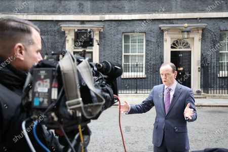 Norman Smith, BBC TV political journalist, talks to camera outside Number 10 Downing Street, before the Chancellor of the Exchequer Rishi Sunak delivers his Budget speech in The House of Commons at lunchtime.