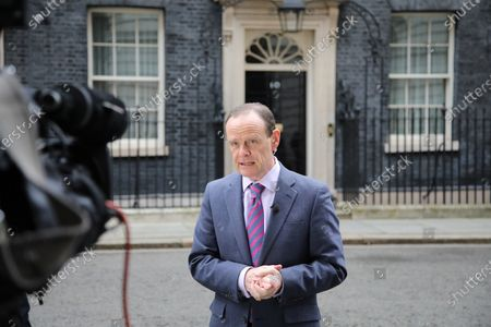 Stock Photo of Norman Smith, BBC TV political journalist, talks to camera outside Number 10 Downing Street, before the Chancellor of the Exchequer Rishi Sunak delivers his Budget speech in The House of Commons at lunchtime.