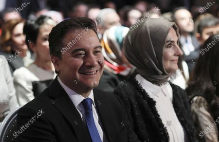 Ali Babacan, an economist, who held various high level government positions between 2002-2015, sits with his wife Ulku Babacan before he announces the details of the program of his new political party, Remedy, in Ankara, Turkey, . Babacan has established a new political party, the second former ally of President Recep Tayyip Erdogan to breakaway from the ruling party and form a new movement to challenge his rule