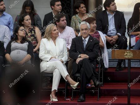 Chile's President Sebastian Pinera sits with his wife, first lady Cecilia Morel, as he waits to take part in a ceremony marking his two years in office, at La Moneda Presidential Palace, in Santiago, Chile, The event coincides with the 30 year anniversary of the country's return to democracy