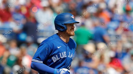 Toronto Blue Jays center fielder Derek Fisher runs to first during a spring training baseball game, in Dunedin, Fla