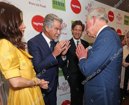 Prince Charles Pierce Brosnan (centre) with a Namaste gesture as he arrives at the annual Prince's Trust Awards 2020 held at the London Palladium