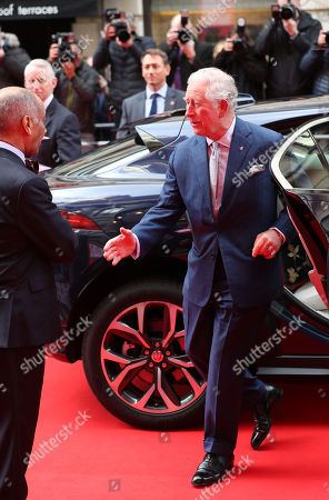 Prince Charles goes to shake the hand of Sir Kenneth Olisa, The Lord-Lieutenant of Greater London (left) before he changes to use a Namaste gesture, as he arrives at the annual Prince's Trust Awards 2020 held at the London Palladium