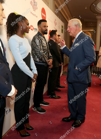 Prince Charles speaks with Dina Asher-Smith as he arrives at the annual Prince's Trust Awards 2020 held at the London Palladium