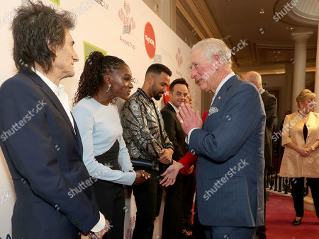 Stock Picture of Prince Charles uses the Namaste gesture to greet Dina Asher-Smith as he arrives at the annual Prince's Trust Awards 2020 held at the London Palladium