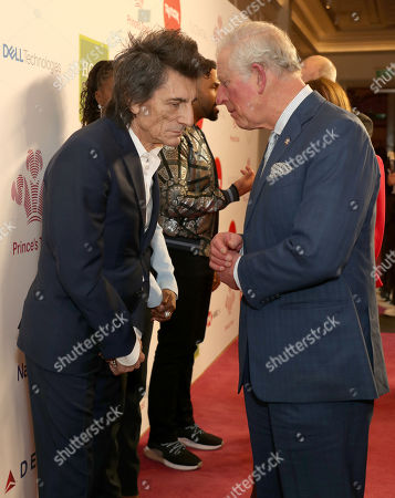 Prince Charles speaks with Rolling Stone Ronnie Wood as he arrives at the annual Prince's Trust Awards 2020 held at the London Palladium