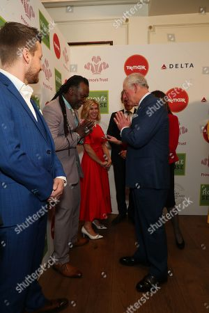 Prince Charles greets Levi Roots with a Namaste gesture as he arrives at the annual Prince's Trust Awards 2020 held at the London Palladium