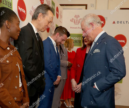Prince Charles speaks with Richard E Grant as he arrives at the annual Prince's Trust Awards 2020 held at the London Palladium