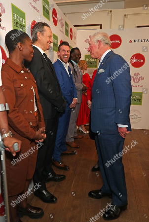 Prince Charles speaks with (left to right) Michaela Coel, Richard E Grant and Chris Ramsey as he arrives at the annual Prince's Trust Awards 2020 held at the London Palladium