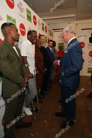 Prince Charles speaks with (left to right) with Michael Ward, Ashley Walters, Michaela Coel, Richard E Grant and Chris Ramsey as he arrives at the annual Prince's Trust Awards 2020 held at the London Palladium