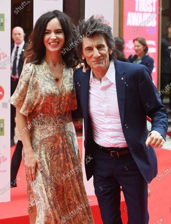 Stock Photo of Ronnie Wood (R) and Sally Wood arrive at the Prince's Trust awards held at the London Palladium London, Britain, 11 March 2020.