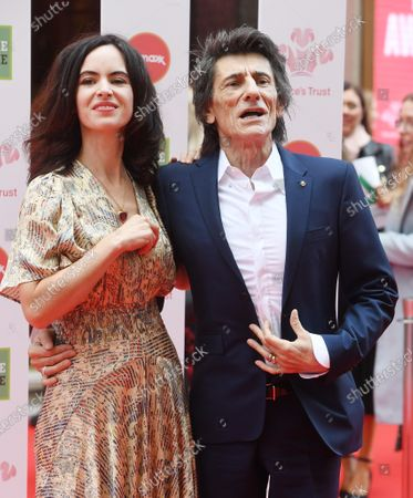 Ronnie Wood (R) and Sally Wood arrive at the Prince's Trust awards held at the London Palladium London, Britain, 11 March 2020.