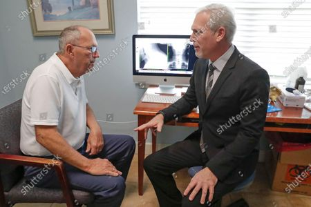 Dr. Mitchell Supler, right, has a discussion with Mike McNally at the Masson Spine Institute in Ocoee, Fla. The McNallys first used a UnitedHealthcare navigator when Mike was preparing for shoulder surgery a few years ago. Navigator Kimberly Eklond intervened. She contacted the hospital and told the Florida couple they didn't have to pay anything early and could actually make no-interest payments after the procedure