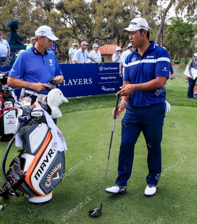 Hideki Matsuyama of Japan (R) compares drivers with Retief Goosen of South Africa (L) while waiting to hit tee shots on the twelfth hole during practice for THE PLAYERS Championship on the Stadium Course at TPC Sawgrass in Ponte Vedra Beach, Florida, USA, 11 March 2020. The contest will run from 12 to 15 March.