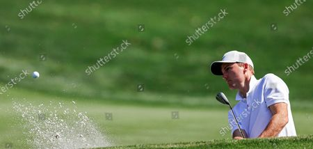 Russell Henley of the US hits form a sand trap by the eleventh green during practice for THE PLAYERS Championship on the Stadium Course at TPC Sawgrass in Ponte Vedra Beach, Florida, USA, 11 March 2020. The contest will run from 12 to 15 March.