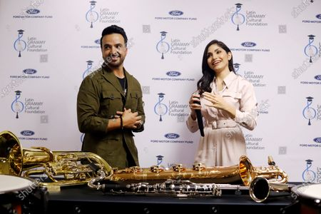 Stock Picture of Puerto Rican artist Luis Fonsi (L) shares his experiences with art students along with TV. host Yizette Cifredo (R) during an event in Guayanilla, Puerto Rico, 11 March 2020. Fonsi delivered on Wednesday musical instruments valued at U$ 20,000 to the Ernesto Ramos Antonini Specialized School of Fine Arts, of Yauco, affected by an earthquake on 06 and 07 January.