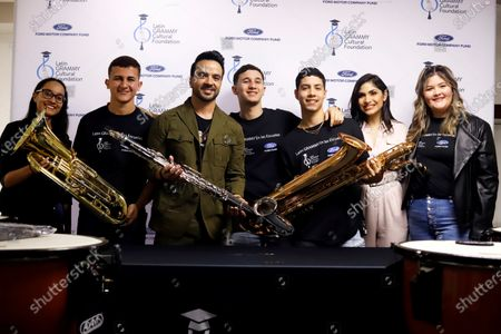 Stock Image of Puerto Rican artist Luis Fonsi (3-L) shares his experiences with art students along with TV. host Yizette Cifredo (2-R) during an event in Guayanilla, Puerto Rico, 11 March 2020. Fonsi donated on Wednesday musical instruments valued at U$ 20,000 to the Ernesto Ramos Antonini Specialized School of Fine Arts, of Yauco, affected by an earthquake on 06 and 07 January.