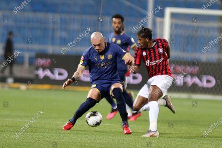 AL- Nassr's Maicon Pereira Roque (L) in action against Al-Raed's Raed Al Ghamdi (R) during the Saudi Professional League soccer match between AL- Nassr and Al-Raed at Prince Faisal bin Fahd Stadium, Riyadh, Saudi Arabia, 11 March 2020.