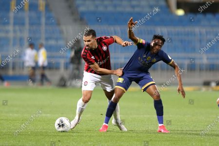 AL- Nassr's Ahmed Musa (R) in action against Al-Raed's Jalal Al Daoudi (L) during the Saudi Professional League soccer match between AL- Nassr and Al-Raed at Prince Faisal bin Fahd Stadium, Riyadh, Saudi Arabia, 11 March 2020.