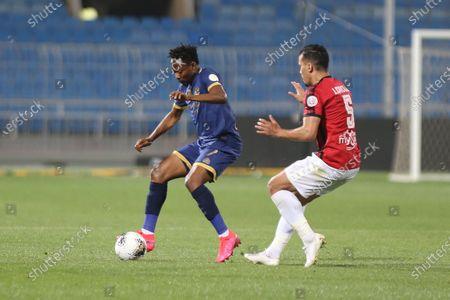 AL- Nassr's Ahmed Musa (L) in action against Al-Raed's Jalal Al Daoudi (R) during the Saudi Professional League soccer match between AL- Nassr and Al-Raed at Prince Faisal bin Fahd Stadium, Riyadh, Saudi Arabia, 11 March 2020.