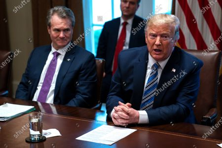 Bank of America CEO Brian Moynihan listens as President Donald Trump speaks during a meeting with banking industry executives about the Coronavirus, at the White House, in Washington