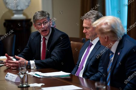 Bank of America CEO Brian Moynihan, center, and President Donald Trump listen as Citi CEO Michael Corbat speaks during a meeting with banking industry executives about the coronavirus, at the White House, in Washington