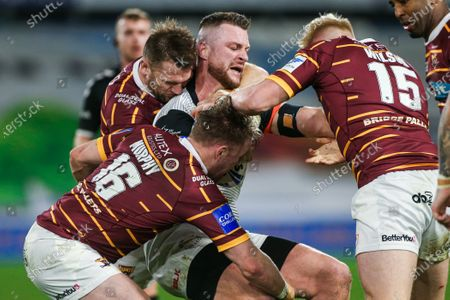 Toronto's Adam Sidlow is tackled by Huddersfield's Paul Clough, Aaron Murphy and Oliver Wilson.