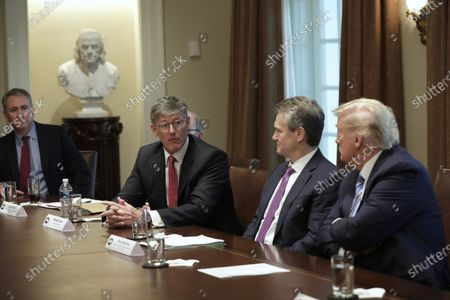 Stock Image of U.S. President Donald J. Trump (R) meets with bankers including Chairman of the Board and CEO Bank of America Brian Moynihan (2-R) and CEO of Citibank Michael Corbat (2-L) on COVID-19 coronavirus response at the White House in Washington, D.C., USA, 11 March 2020.