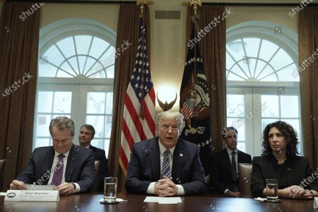 U.S. President Donald Trump (C) meets with bankers including Chairman of the Board and CEO Bank of America Brian Moynihan (L) and President and CEO of Independent Community Bankers of America Rebeca Romero Rainey (R) on COVID-19 coronavirus response at the White House in Washington, D.C., USA, 11 March 2020.