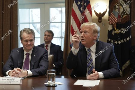 U.S. President Donald J. Trump (R) meets with bankers including Chairman of the Board and CEO Bank of America Brian Moynihan (L) on COVID-19 coronavirus response at the White House in Washington, D.C., USA, 11 March 2020.