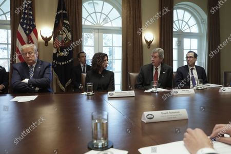(L-R) U.S. President Donald J. Trump (L) meets with bankers including President and CEO of Independent Community Bankers of America Rebeca Romero Rainey, Chairman and CEO of Truist Financial Corporation Kelly King and US Secretary of Treasury Steven Mnuchin on COVID-19 coronavirus response at the White House in Washington, D.C., USA, 11 March 2020.